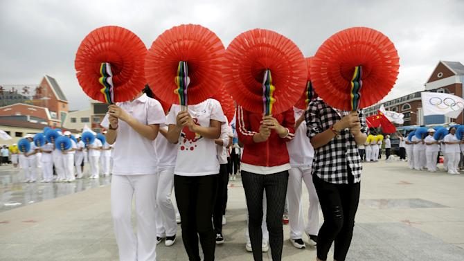 Local residents perform during a rehearsal in Chongli county of Zhangjiakou