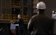 A shipyard worker listens as U.S. President Barack Obama speaks at Newport News Shipbuilding in Newport News, Virginia February 26, 2013. REUTERS/Kevin Lamarque