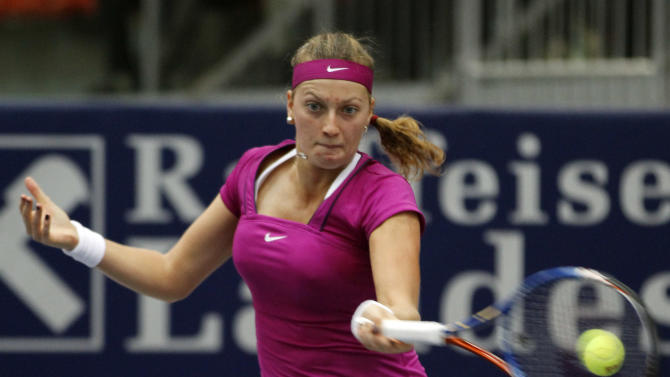 Czech Republic's Petra Kvitova returns the ball to Dominika Cibulkova of Slovakia during the final of the WTA Generali Ladies Tournament in Linz, Austria, on Sunday, Oct. 16, 2011.  Wimbledon champion Petra Kvitova beat Dominika Cibulkova of Slovakia 6-4, 6-1 Sunday to win the Generali Ladies for her fifth title of the season and sixth overall. The top-seeded Kvitova, ranked on a career-high fourth, is now 6-2 in career finals. The seventh-seeded Cibulkova, who is yet to win a title, was in her first final since 2008. Only top-ranked Caroline Wozniacki, who won six events, has earned more WTA titles this season than Kvitova. (AP Photo/Ronald Zak)