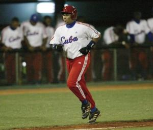 File photo of Cuban baseball player Cepeda scoring a home run against South Korea, in the fourth inning of their elimination game at the 35th Baseball World Championships in Havana