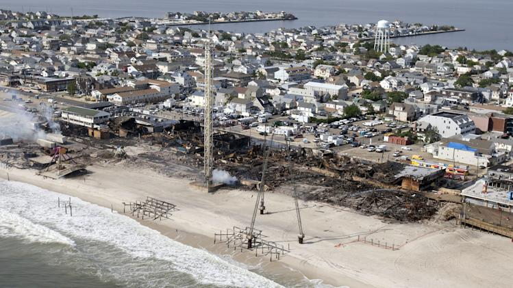 This aerial photo shows aftermath of a massive fire that burned a large portion of the Seaside Park boardwalk, Friday, Sept. 13, 2013, in Seaside Park, N.J. The fire, which apparently started Thursday near an ice cream shop and spread several blocks, hitting the recently repaired boardwalk, which was damaged last year by Superstorm Sandy. (AP Photo/The Asbury Park Press, Bob Bielk)