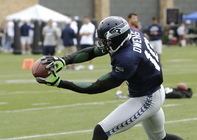 Seattle Seahawks&#39; Terrell Owens catches a pass during NFL football training camp, Wednesday, Aug. 8, 2012, in Renton, Wash. (AP Photo/Ted S. Warren)
