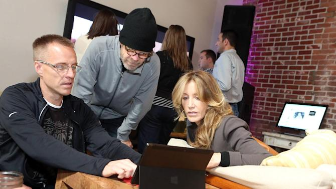 IMAGE DISTRIBUTED FOR MICROSOFT- William H. Macy, center, and Felicity Huffman are seen at The Microsoft Experience, on Thursday, Dec. 6, 2012 in Venice Beach, Calif. (Photo by Casey Rodgers/Invision for Microsoft/AP Images)