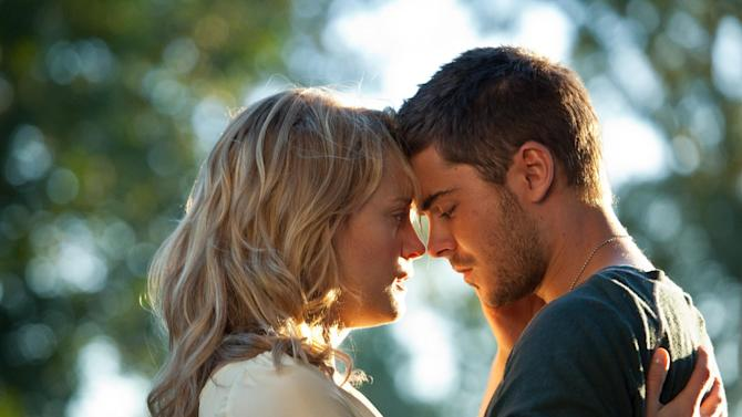 """In this film image released by Warner Bros, Taylor Schilling, left, and Zac Efron are shown in a scene from """"The Lucky One."""" (AP Photo/Warner Bros., Alan Markfield)"""