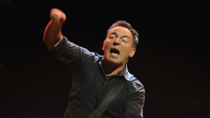 "FILE - In this May 3, 2013 file photo, U.S. singer-songwriter Bruce Springsteen performs with the E-Street Band at a concert in Stockholm. On Tuesday, July 16, Springsteen dedicated his protest song ""American Skin (41 Shots) to the late teen Trayvon Martin at a concert in Limerick, Ireland. (AP Photo/Henrik Montgomery) SWEDEN OUT"