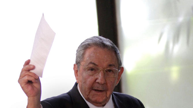 Cuba's President Raul Castro holds up the ballot of his brother Fidel, also present in the session,  for president of the National Assembly during the opening session of the parliament in Havana, Cuba, Sunday, Feb. 24, 2012.  Cuba's parliament reconvened Sunday with new membership and was expected to name Raul Castro to a new five-year-term as president. He fueled speculation on Friday when he talked of his possible retirement and suggested he has plans to resign at some point.(AP Photo/Ismael Francisco, Cubadebate)
