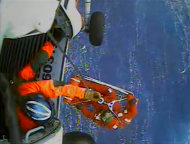 In this image made from video and released by the U.S. Coast Guard, a USCG crew member uses a hoist to bring up a survivor into a helicopter. A replica tall ship caught in Hurricane Sandy&#39;s wrath began taking on water, forcing the crew to abandon the boat Monday in rough seas off the North Carolina coast. The Coast Guard rescued 14 crew members by helicopter, but two people were still missing. (AP Photo/U.S. Coast Guard)