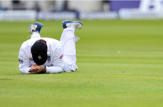 England cricketer Andrew Strauss reacts after missing a catch during the fourth day of the first Test against the West Indies at Lords cricket ground in London, England on May 20, 2012. AFP PHOTO/GLYN