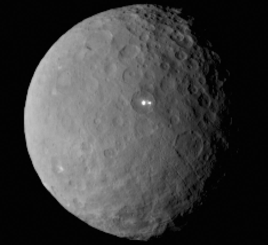 Bright lights on dwarf planet perplex NASA as probe nears