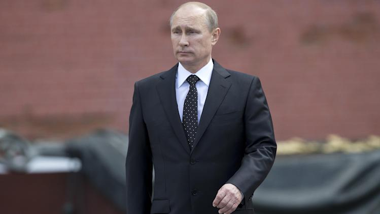 In this photo taken on Sunday, June 22, 2014, Russian Vladimir Putin takes part in a wreath laying ceremony at the Tomb of the Unknown Soldier outside Moscow's Kremlin Wall, in Moscow, Russia, to mark the 73rd anniversary of the Nazi invasion of the Soviet Union. Russian news agencies say President Vladimir Putin has asked parliament to cancel a resolution that sanctions the use of military force in Ukraine. Putin wrote to the head of parliament's upper house asking that a March 1 request authorizing the use of force in neighboring Ukraine be withdrawn. (AP Photo/Alexander Zemlianichenko)