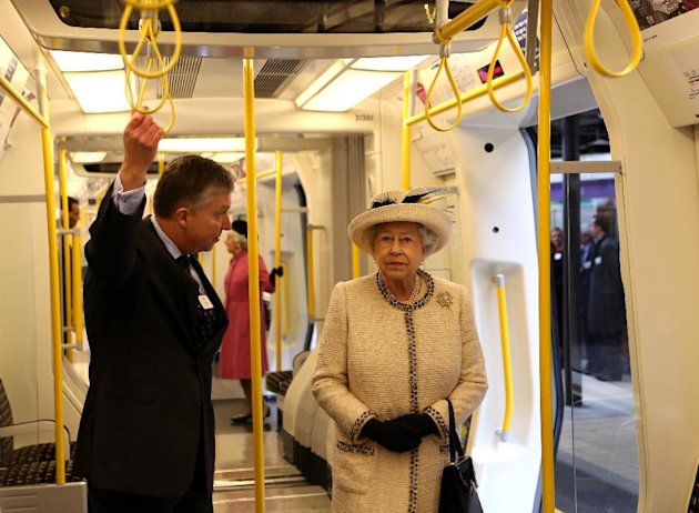 Britain&#39;s Queen Elizabeth II is shown round the carriage of a parked train at Baker Street underground station in London, for a visit to mark the 150th anniversary of the London Underground, Wednesday, March 20, 2013. The Queen made her first public engagement in more than a week Wednesday after cancellations following her hospitalization for a stomach bug. The British head of state joined her husband Prince Philip and their granddaughter-in-law, Kate, for the event marking the 150th anniversary of London&#39;s sprawling subway system, affectionately known as the Tube. (AP Photo/Chris Radburn, Pool)