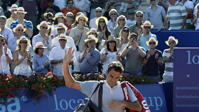 Roger Federer of Switzerland leaves the center court after he lost the second round match against Daniel Brands from Germany at the Suisse Open tennis tournament in Gstaad, Switzerland, Thursday July 25, 2013. (AP Photo/Keystone, Peter Schneider)