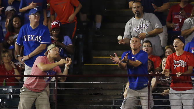 Texas Rangers right fielder Shin-Soo Choo watches a home run by Los Angeles Angels' Kole Calhoun during the fourth inning of a baseball game in Arlington, Texas, on Saturday, July 4, 2015. (AP Photo/Brad Loper)