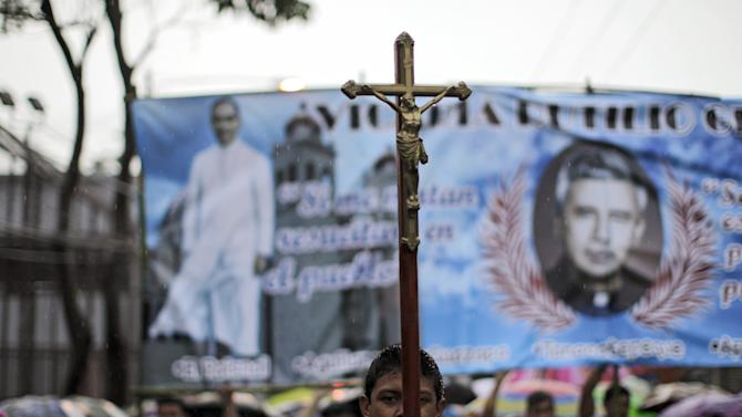 Catholic faithfuls participate in a procession for the late archbishop of San Salvador Oscar Arnulfo Romero during a procession in San Salvador