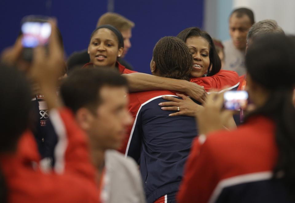 First lady Michelle Obama hugs basketball player Tamika Catchings after speaking during a breakfast with Team USA at the 2012 Summer Olympics, Friday, July 27, 2012, in London. (AP Photo/Darron Cummings)