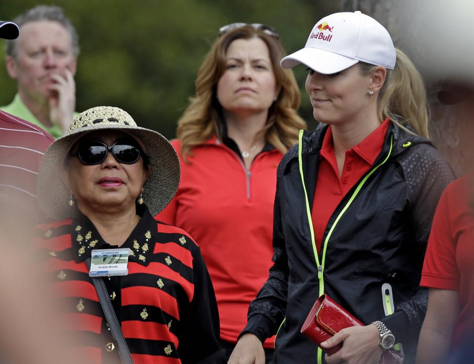 Tiger Woods' mother Kultida Woods and skier Lindsey Vonn watch Woods during the fourth round of the Masters golf tournament Sunday, April 14, 2013, in Augusta, Ga. (AP Photo/David J. Phillip)