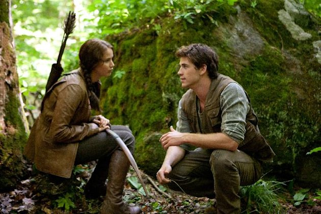 "In this image released by Lionsgate, Jennifer Lawrence portrays Katniss Everdeen, left, and Liam Hemsworth portrays Gale Hawthorne in a scene from ""The Hunger Games."" (AP Photo/Lionsgate, Murray Close)"
