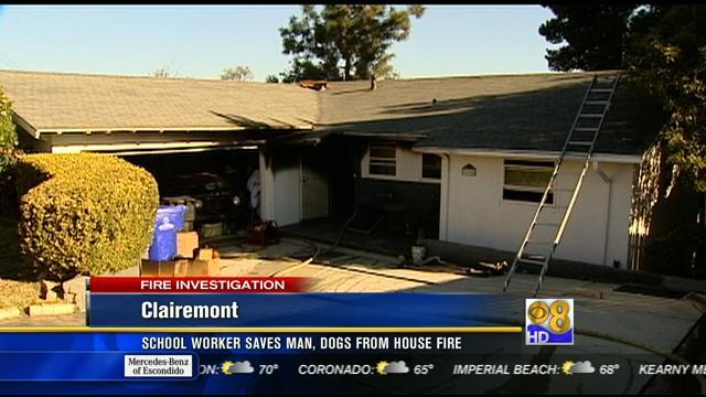 School worker saves man, dogs from house fire in Clairemont