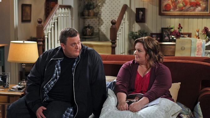 """In this image released by CBS, Billy Gardell, left, and Melissa McCarthy are shown in a scene from the sitcom """"Mike & Molly."""" Arizona tribal members say they're shocked by the sitcom after one of the characters on the CBS show joked last week about drunken Indians in Arizona. Navajo Nation spokesman Erny Zah says while alcoholism is easy to judge from the outside, the disease isn't funny. He says it can lead to assaults, break up families and instill fear in children. The Native American Journalists Association says CBS should apologize. (AP Photo/CBS, Michael Ansell)"""