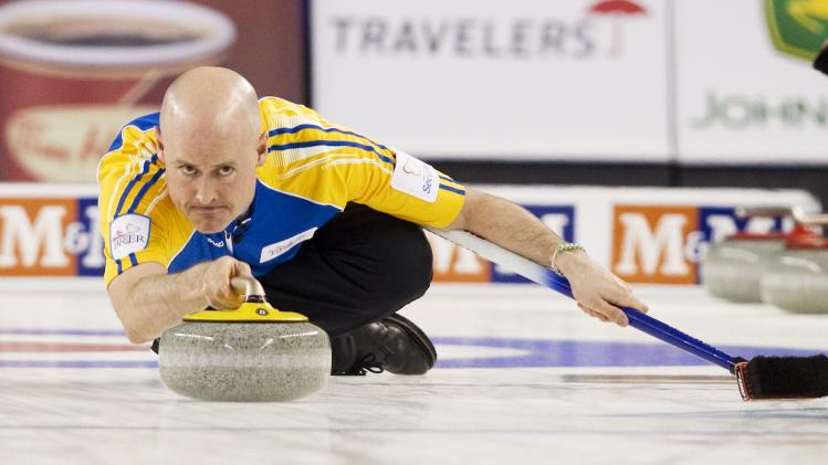 Team Alberta's skip Kevin Koe throws a rock in the first end against team British Columbia during the championship draw at the 2014 Tim Hortons Brier curling championships in Kamloops.