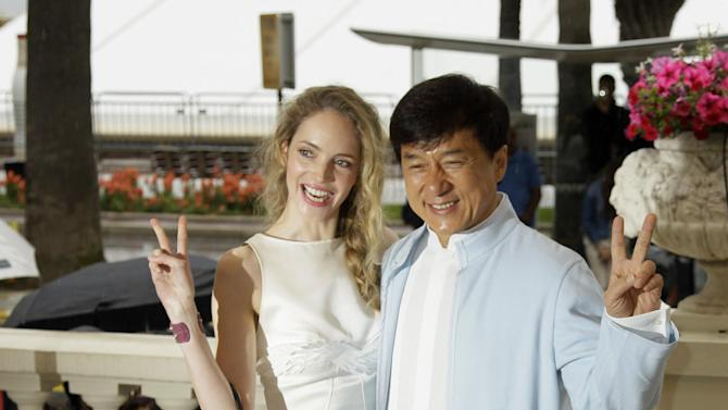 Actress Laura Weissbecker, left and director Jackie Chan pose during a photo call for Chinese Zodiac at the 65th international film festival, in Cannes, southern France, Friday, May 18, 2012. (AP Photo/Francois Mori)