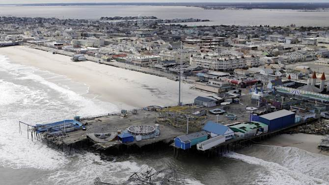 """FILE - This Oct. 31, 2012 file aerial photo shows the damage to an amusement park left in the wake of Superstorm Sandy, in Seaside Heights, N.J. The National Hurricane Center now says tropical force winds from Sandy extended 820 miles at its widest, down from an earlier estimate of 1,000 miles. Its pure kinetic energy for storm surge and wave """"destruction potential"""" reached a 5.8 on the National Oceanic and Atmospheric Administration's 0 to 6 scale, the highest measured. (AP Photo/Mike Groll, File)"""