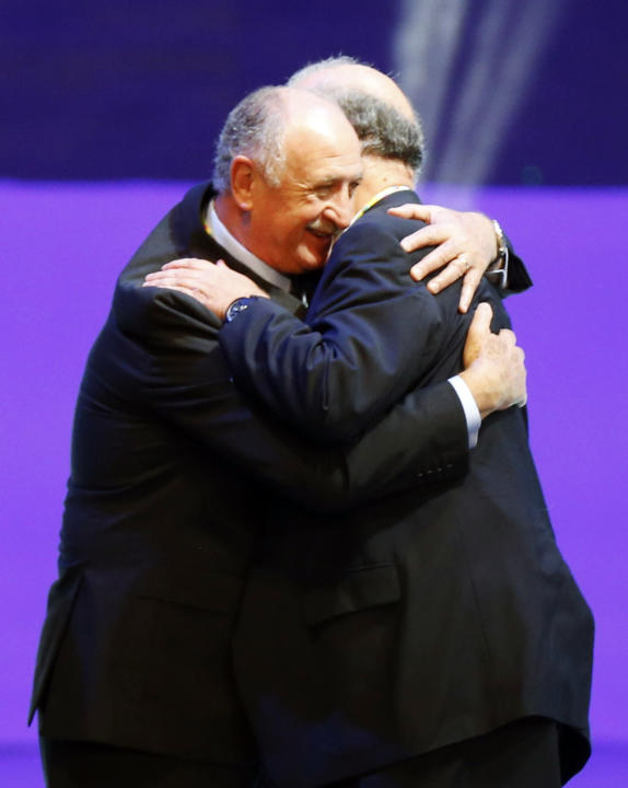 Brazil's coach Luiz Felipe Scolari hugs Spain's coach Vicente del Bosque after the draw for the 2014 World Cup finals was made at the Costa do Sauipe resort in Sao Joao da Mata