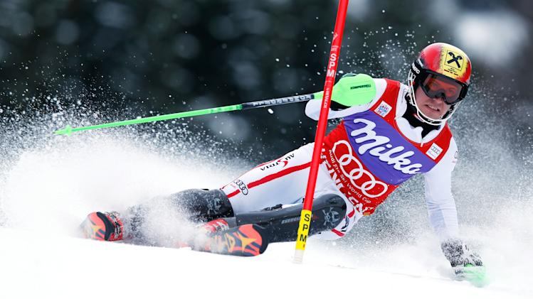 Austria's Marcel Hirscher speeds past a pole on his way to clock the fastest time in the first run of an Alpine ski World Cup men's slalom, in Wengen, Switzerland, Sunday, Jan. 20, 2013. (AP Photo/Shinichiro Tanaka)