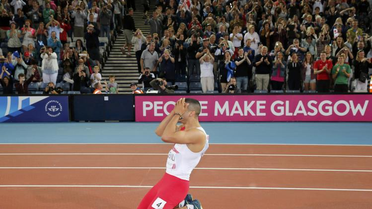 Gemili of England celebrates his silver medal finish after the men's 100m final at the 2014 Commonwealth Games in Glasgow