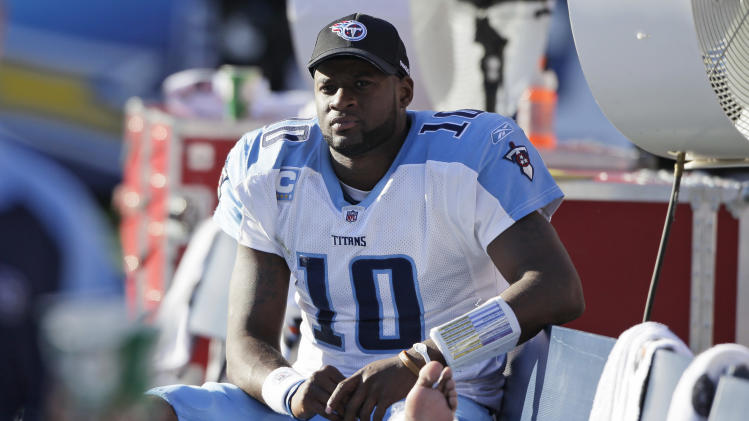 Tennessee Titans quarterback Vince Young sits on the bench with his leg wrapped after receiving an injury while playing the San Diego Chargers in an NFL football game Sunday, Oct. 31, 2010, in San Diego. The Chargers won 33-25. (AP Photo/Gregory Bull)