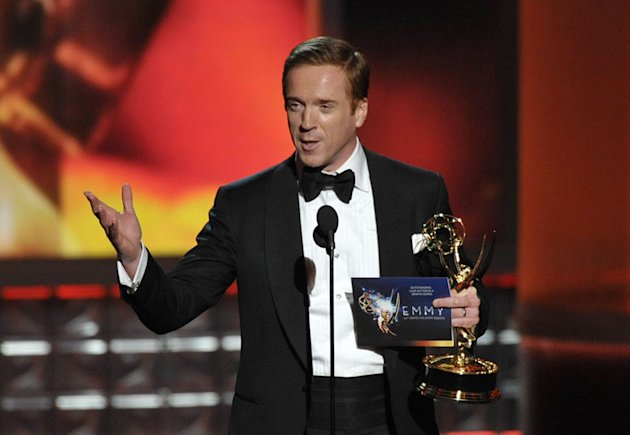 "Damian Lewis accepts the award for Outstanding Lead Actor In A Drama Series for ""Homeland"" at the 64th Primetime Emmy Awards at the Nokia Theatre on Sunday, Sept. 23, 2012, in Los Angeles. (Photo by John Shearer/Invision/AP)"