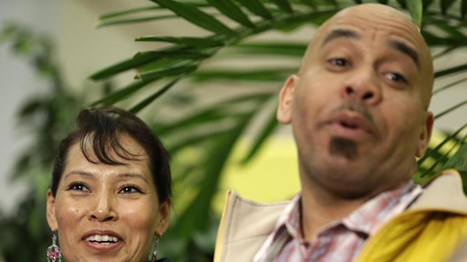 CORRECTS AGE TO 45 INSTEAD OF 44 - Pedro Quezada, right, the winner of the Powerball jackpot, stands next to his wife, Ines Sanchez, during a news conference at the New Jersey Lottery headquarters, Tuesday, March 26, 2013, in Lawrenceville, N.J. Quezada, 45, won the $338 million jackpot with the winning ticket he purchased at Eagle Liquors store in Passaic, N.J. (AP Photo/Julio Cortez)