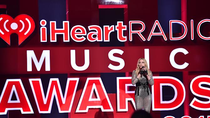 Madonna speaks on stage at the iHeartRadio Music Awards at The Shrine Auditorium on Sunday, March 29, 2015, in Los Angeles.  (Photo by John Shearer/Invision for iHeartRadio/AP Images)