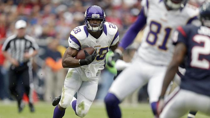 Minnesota Vikings running back Adrian Peterson (28) rushes for a gain during the first quarter of an NFL football game against the Houston Texans, Sunday, Dec. 23, 2012, in Houston. (AP Photo/Patric Schneider)