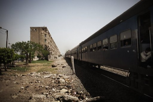 A train passes through the Egyptian Delta region, 50 kms north of the capital Cairo, in May 2012. A train derailed and crashed south of Cairo on Tuesday, leaving an unknown number of people dead and injured, an Egyptian security source said. 