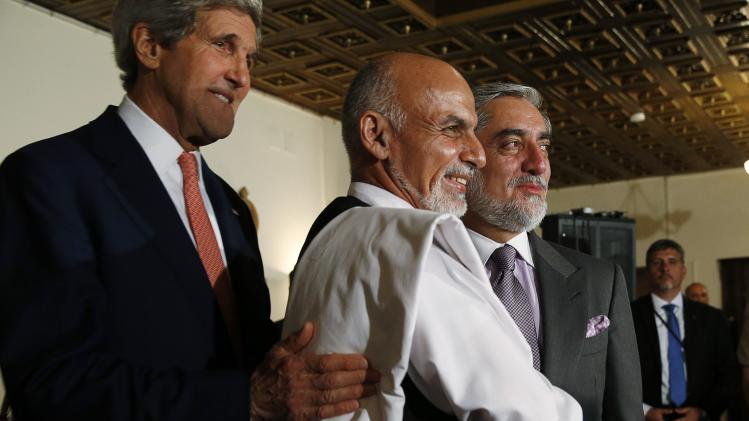 U.S. Secretary of State Kerry holds a news conference with Afghanistan's presidential candidates Abdullah and Ghani at the United Nations Special Representative's residence in Kabul