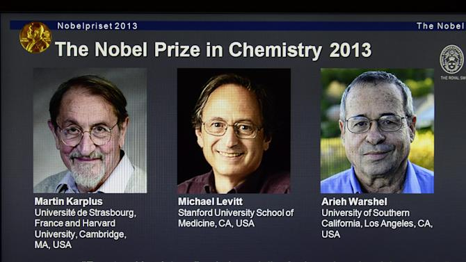 This Wednesday Oct. 9, 2013 photo shows a webpage showing the laureates Martin Karplus, Michael Levitt and Arieh Warshel as winners of the 2013 Nobel Prize in chemistry, announced by the Royal Swedish Academy of Sciences in Stockholm. The prize was awarded for laying the foundation for the computer models used to understand and predict chemical processes. (AP Photo/Claudio Bresciani) SWEDEN OUT