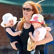Marcia Cross sure doesn't dress like a desperate housewife—even when she's super-casual in the park with her girls, she looks seriously chic. Photo: celebritybabyscoop.com