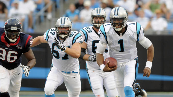 Carolina Panthers quarterback Cam Newton (1) scrambles as teammates Ryan Kalil (67) and Geoff Hangartner (63) block against Houston Texans' Tim Jamison (96) during the first half of an NFL preseason football game in Charlotte, N.C., Saturday, Aug. 11, 2012. (AP Photo/Mike McCarn)