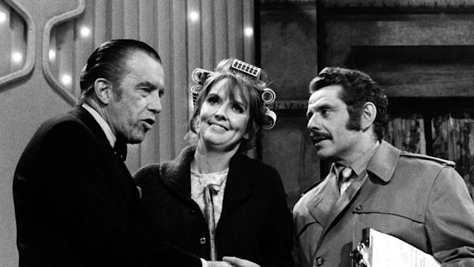 FILE- In this May 29, 1970, file photo, Jerry Stiller, right, and Anne Meara, center, appear with host Ed Sullivan. Meara, whose comic work with husband Jerry Stiller helped launch a 60-year career in film and TV, has died. She was 85. Jerry Stiller and son Ben Stiller say Meara died Saturday, May 23, 2015. (AP Photo/File)