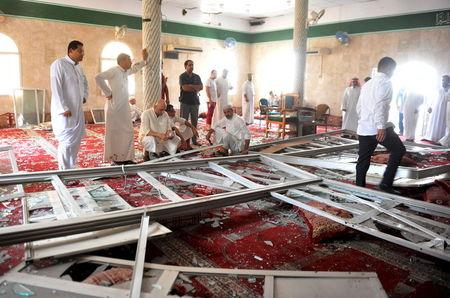 Family members of victims and well wishers are seen after a suicide bomb attack at the Imam Ali mosque in the village of al-Qadeeh in the eastern province of Gatif