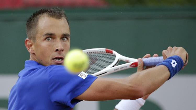 Czech Republic's Lukas Rosol hits a return to Czech Republic's Jiri Vesely during their French tennis Open first round match at the Roland Garros stadium in Paris on May 26, 2014