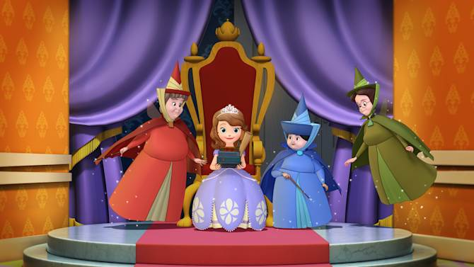 """This image released by Disney Junior shows the animated character Princess Sofia, voiced by Ariel Winter, seated, surrounded by her fairy Godmothers, Flora, left, Merryweather and Fauna, right, from the upcoming series """"Sofia the First."""" The new series, about a girl who is learning to adjust to royal life after her mom marries the king, airs  Jan. 11, 2013 on the Disney Channel and Disney Junior networks. (AP Photo/Disney Junior)"""