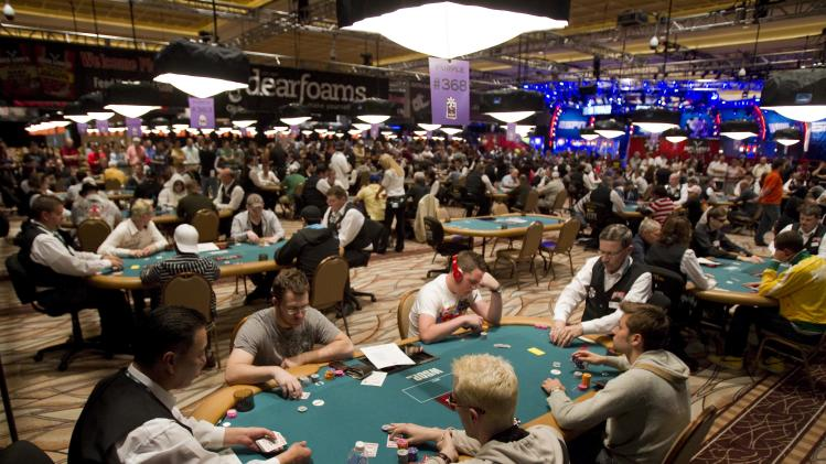 FILE - In this May 31, 2011 file photo, players compete in a Heads-Up poker tournament during the World Series of Poker at the Rio hotel and casino in Las Vegas. At the height of the poker fad, Las Vegas couldn't get enough of poker rooms. Now some of those rooms are folding. Four casinos yanked their poker tables last year, including the Tropicana, and three other rooms closed shop in 2011. (AP Photo/Eric Jamison, File)