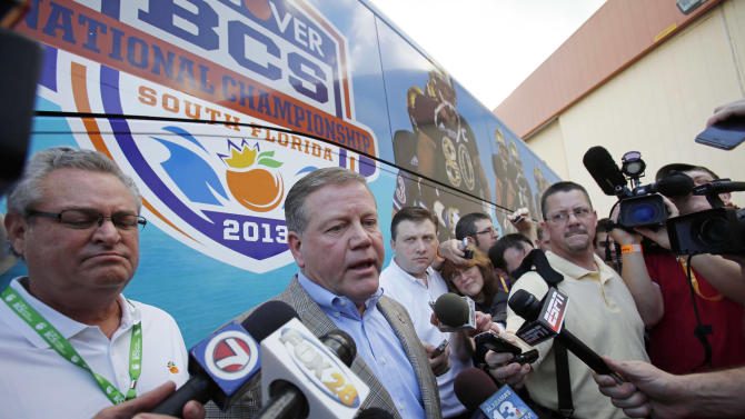 Notre Dame head coach Brian Kelly talks to reporters after arriving in Fort Lauderdale, Fla., Wednesday, Jan. 2, 2013. Notre Dame takes on Alabama in the BCS national championship NCAA college football game next Monday in Miami. (AP Photo/Alan Diaz)