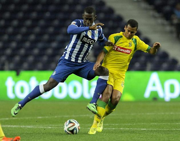 FC Porto's Jackson Martinez, left, from Colombia challenges Pacos Ferreira's Rodrigo Antonio, from Brazil, in a Portuguese League soccer match at the Dragao stadium in Porto, Portugal, Sunday,