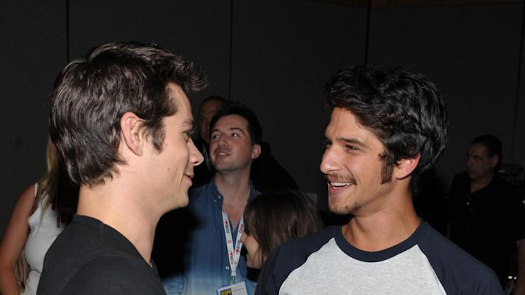 "Dylan O'Brien, left, and Tyler Posey speak backstage at the ""Teen Wolf"" panel at the San Diego Convention Center on Day 2 of Comic-Con International on Thursday, July 18, 2013, in San Diego, Calif. (Photo by John Shearer/Invision for MTV/AP)"