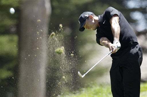 Furyk, McDowell share the lead as Tiger tumbles