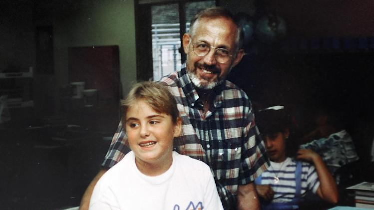 This early 1990's photo provided by the Rousseau family shows Lauren Rousseau as an elementary school student, left, with her teacher George Hochsprung, right, in Danbury Conn.  Lauren Rousseau, 30, a substitute teacher at Sandy Hook Elementary School was killed Dec. 14, 2012, along with George Hochsprung's wife Dawn Lafferty Hochsprung, the school's principal, when a gunman opened fire at Newtown, Conn. school.  Dawn Hochsprung and Lauren Rousseau will be two of six educators from the school honored posthumously with the 2012 Presidential Citizens Medal, presented at a White House ceremony on Feb. 15, 2013. (AP Photo/Jessica Hill)