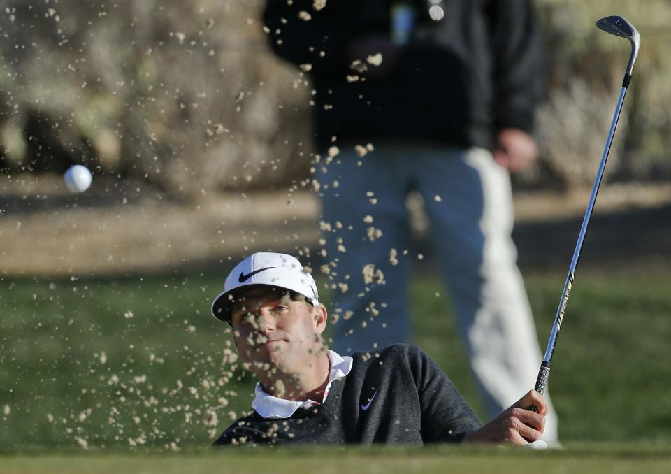 Nick Watney hits out of the bunker onto the second green in the second round of play against Steve Stricker during the Match Play Championship golf tournament, Friday, Feb. 22, 2013, in Marana, Ariz. Stricker won 1 up in 21 holes. (AP Photo/Ross D. Franklin)